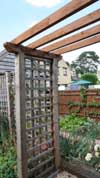 wooden_arch_provides_access_into_decorative_but_productive_potager_with_fan-trained_apple_trees_trained_against_the_fence